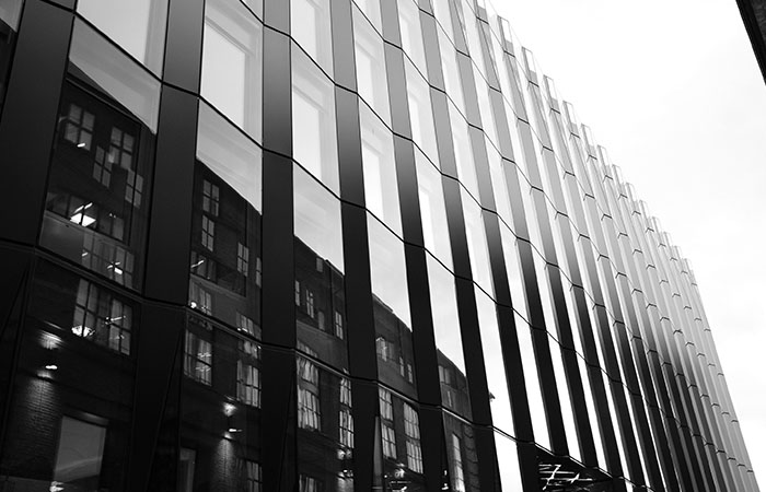 Office building reflecting residential property