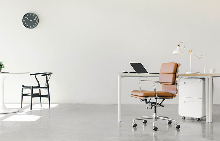 Office furniture to represent dealing with furniture after a business moves to a hybrid working model.